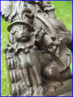 ANTIQUE DOOR STOP folk art JOKER & DOG old CAST IRON jester rare ESTATE SALE