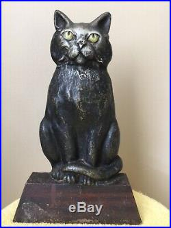 ANTQ. 1920s BLACK CAT, GREEN EYES, CURLED TAIL SITTING ON WEDGE IRON DOORSTOP
