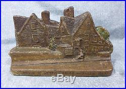Antique Cast Iron House of Seven Gables Doorstop