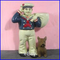 Cracker Jack sailor w scotty dog cast iron door stop 8 5.4lb kno