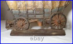 Large antique 1930 original hand painted cast iron covered wagon doorstop
