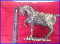 Old cast iron door stop horse