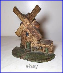 Original antique hand painted heavy cast iron figural windmill house doorstop